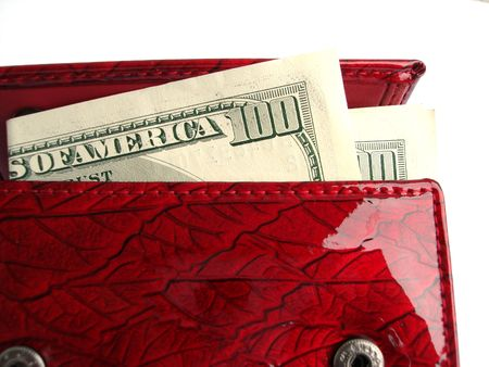 Red wallet with one hundred dollars isolated on a white background photo