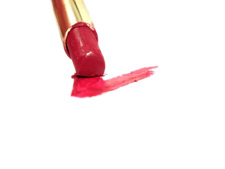 drawing a tick or letter V with red lipstick on white photo