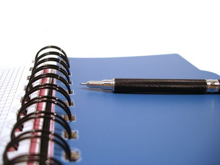 private schools: blue notebook with black pencil
