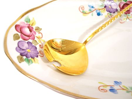 beautiful plate and golden spoon over white background Stock Photo - 736436