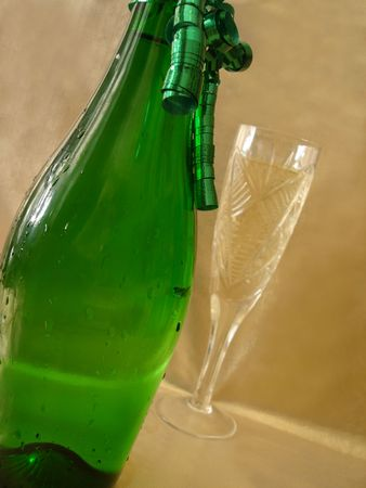 Close-up view bottle and Champagne glasses on golden background photo