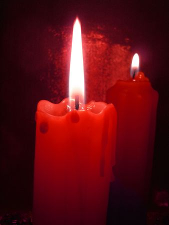 christmas scent: Two red candles in darkness