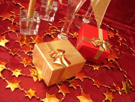 golden and red gift boxes, stars on beautiful background with champagne glasses photo