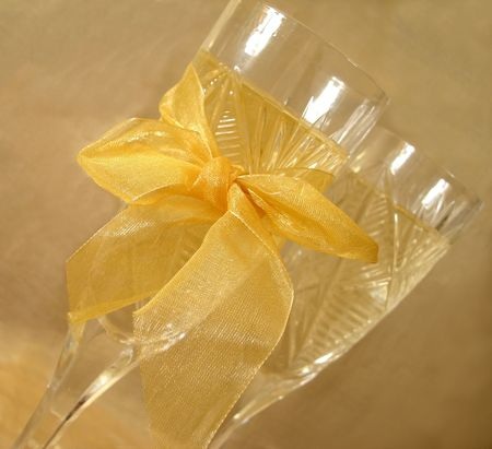 Close-up view of Champagne glasses with bow on golden background Stock Photo - 763801