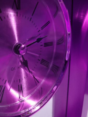 watchmaker: closeup of violet clock