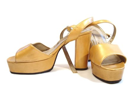 beautiful yellow woman shoes isolated on white background photo