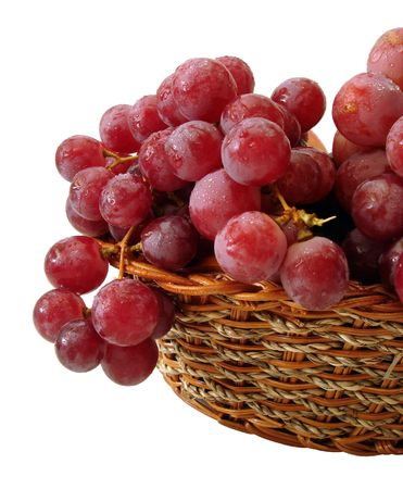 red grapes with drop of water on basket isolated photo