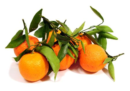 many orange tangerine with green leaves over white background photo