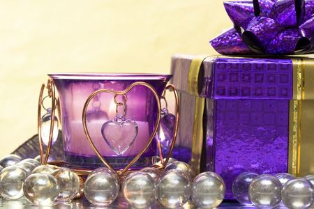 violet candle with heart and gift box Stock Photo - 2966592
