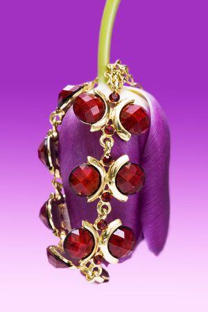 Red bracelet on violet flower Stock Photo - 2966594