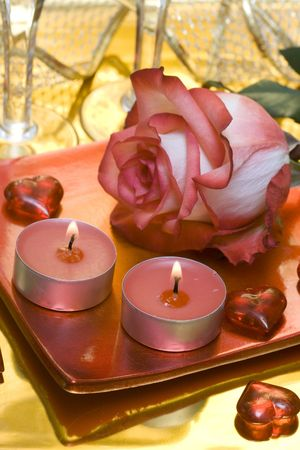 candles with rose and hearts  photo