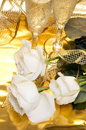 adorn: celebration table, rose and glasses with champagne