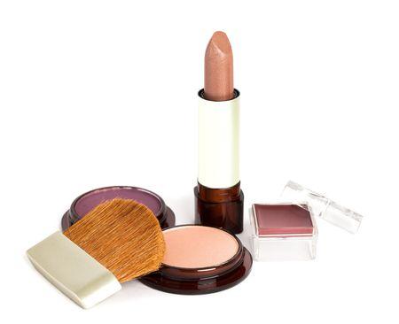 lipstick, eyeshadows and cosmetic brush photo