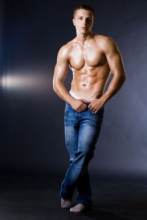 sexy male model: young bodybuilder man on black background Stock Photo