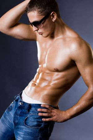 young bodybuilder man on black background Stock Photo - 6542789