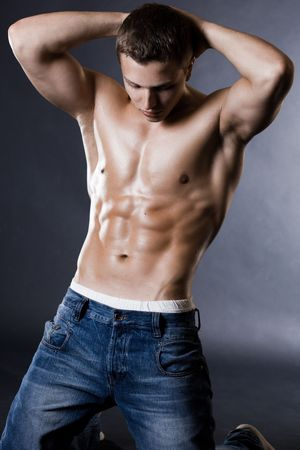 young bodybuilder man on black background photo