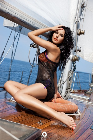 Girl on a yacht in the summer photo