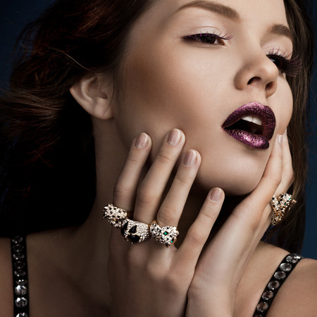 elegant fashionable woman with rings photo