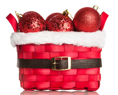 Christmas decorations on red basket Stock Photo