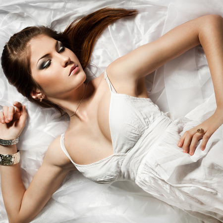 elegant fashionable woman in white cloth photo