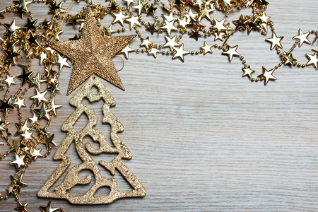 fir-tree with star on wooden background photo
