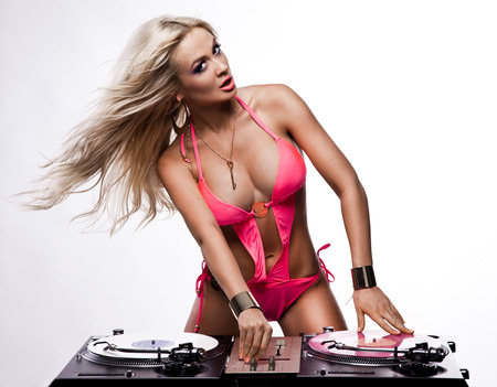 Woman in lingerie with DJ setup photo