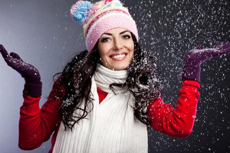 beautiful fashionable woman with snow photo