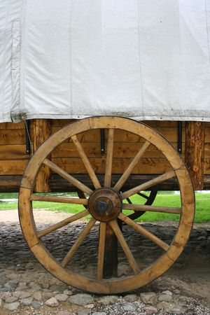 Old carriage and a wheel