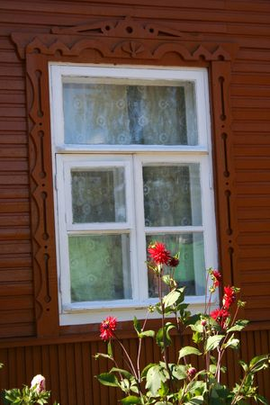 Russian style window and dahlias.