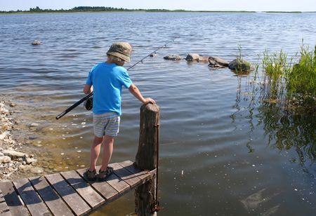 Young boy fishing