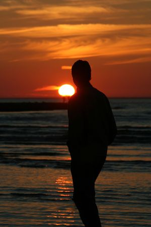 Young man watching sunset