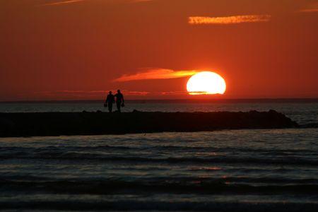 Romantic men at sunset