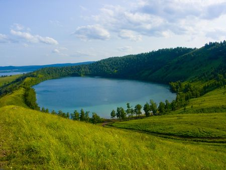 the image of the lake located in a hollow of a hill Reklamní fotografie - 2547504
