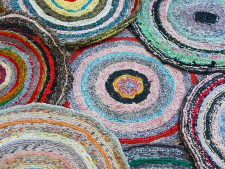A background from several knitted doormats. photo