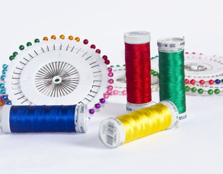 The image of strings for a machine embroidery and pins photo