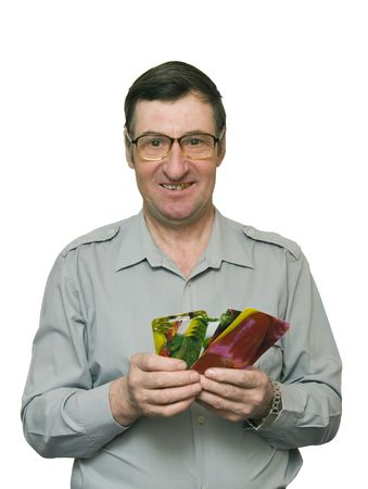 the Image of the man paper packages in which seeds of vegetable cultures are packed photo