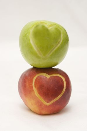which: The image of two apples on which hearts are cut out Stock Photo