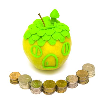 the Image of an apple and a fence from coins Stock Photo - 4751575