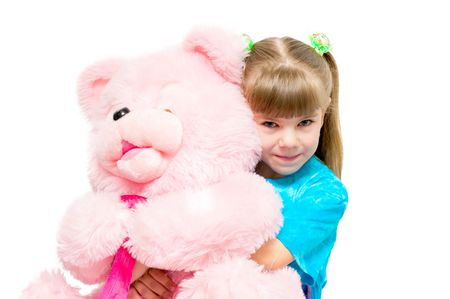 The image of the girl embracing a pink bear photo
