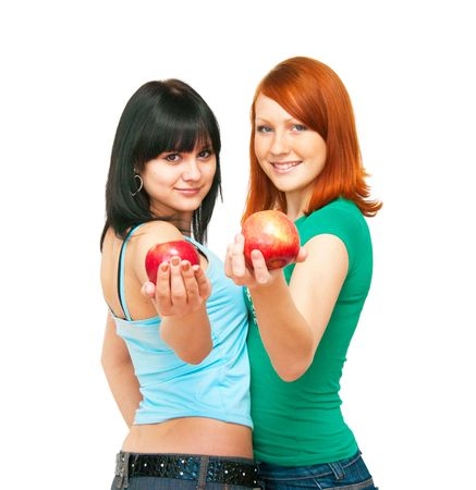 The image of two girls stretching apples Stock Photo - 4785132