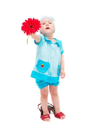 The image of the little girl with a flower on a white background. A flower not in focus photo