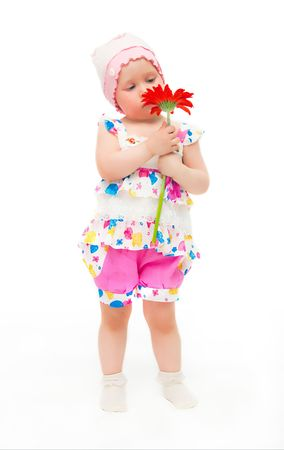 The image of the little girl with a flower on a white background. Stock Photo - 4886930