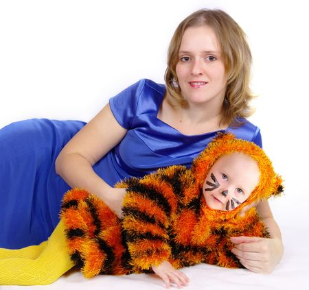The image of the elegant woman and the girl in a suit of a tiger photo
