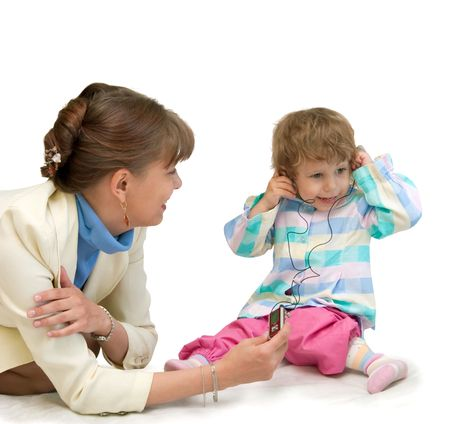 echoes: The woman has allowed to the child to listen to a player