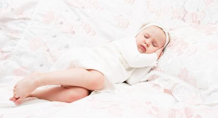 The image of the little girl, gathering to sleep on lacy bed Stock Photo - 6388829
