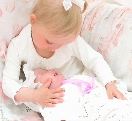 girl bonding: The image of the girl and its newborn sister Stock Photo
