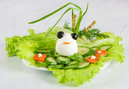 frog egg: Frog from egg for an ornament of cucumber cutting Stock Photo