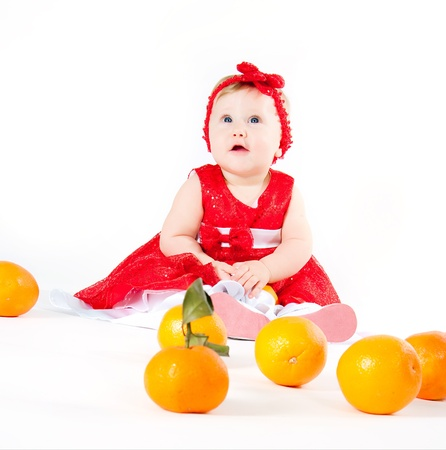 The image of the girl playing with oranges Stock Photo