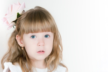 timid: The image of the timid girl with a flower in hair Stock Photo