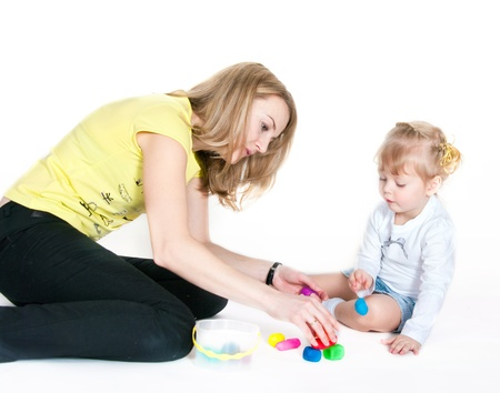 nurser: The woman and the girl are going to mold from plasticine Stock Photo